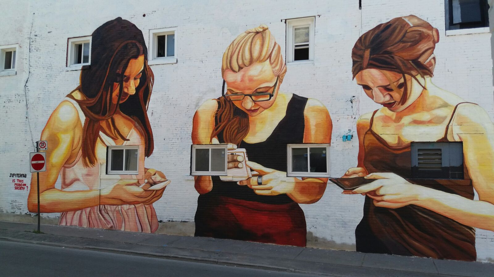 Mural about technology abuse in Canada