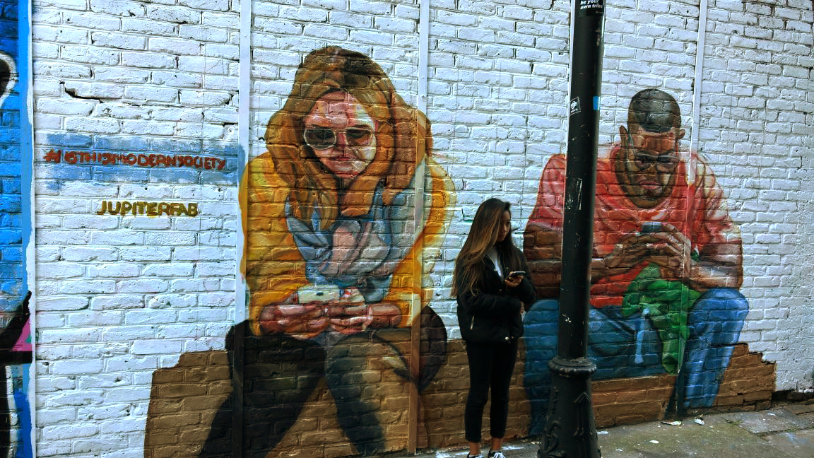 Mural about mobile abuse in London, UK