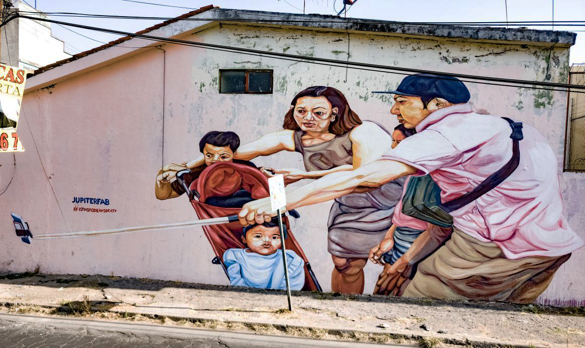 Mural about mobile addiction in Puebla, Mexico